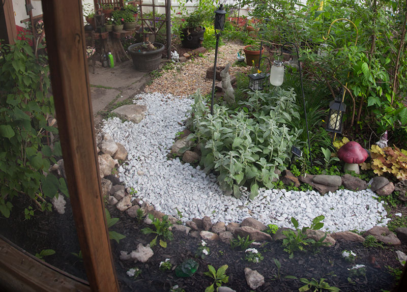 In the foreground is the moon garden, filled with night scented plants, as well as white bloomers which will glow nicely against the black mulch. Going further back you find more night scented plants, including those which could be overpowering up close