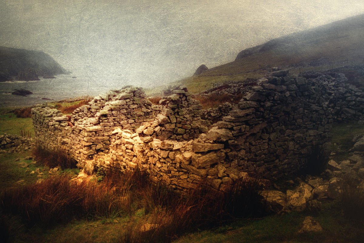 Photo of The cottages of the abandoned village of Port, in Donegal, Ireland in the rain
